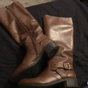 Calf high brown leather boots.
